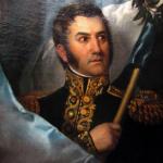 El general José de San Martín, libertador de vastos territorios en América del Sur en sus años de gloria. La autoría del retrato se le atribuye al pintor Jean Baptiste Madou, aunque no se ha logrado establecer con total seguridad. (Fuente: wikipedia).