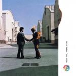 """Portada del disco """"Wish you were here"""", lanzado en 1975, en un sentido homenaje al fundador de Pink Floyd, el enigmático Syd Barret. La portada del disco, de Storm Thorgerson, necesitó que un doble de riesgo usara un traje ignífugo."""